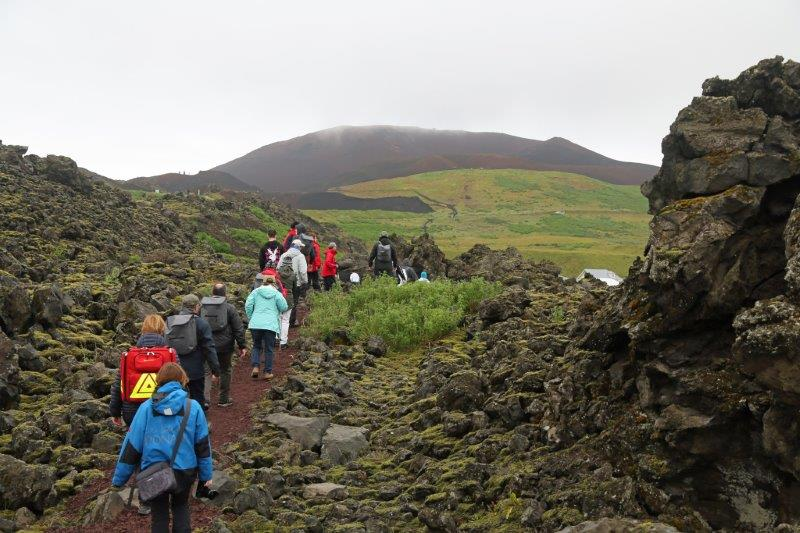guests-on-volcano-walk-at-heimaey-iceland